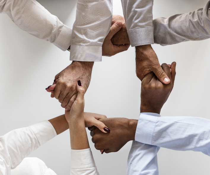 business-hands-joined-together-teamwork